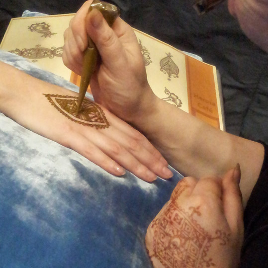 Getting a henna tattoo at the Destinations Show