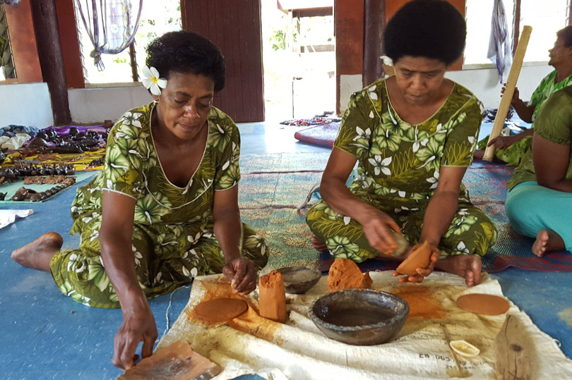 Ladies making pottery in Fiji