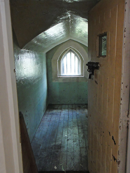 Original old jail cell in what is now a prison themed hostel